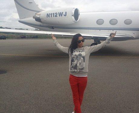Rihanna next to a private jet.