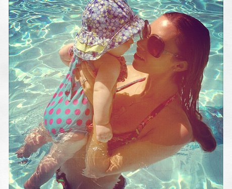 Una Healy in the pool with baby Aoife