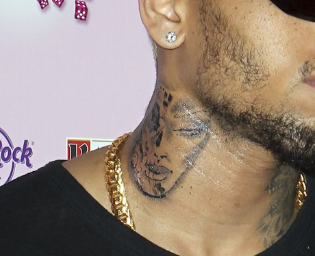 Chris Brown shows of tattoo on his neck