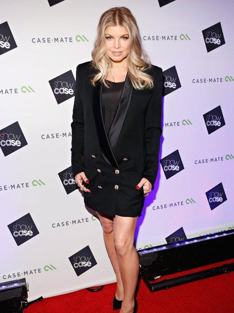 Fergie wearing a tuxedo jacket.