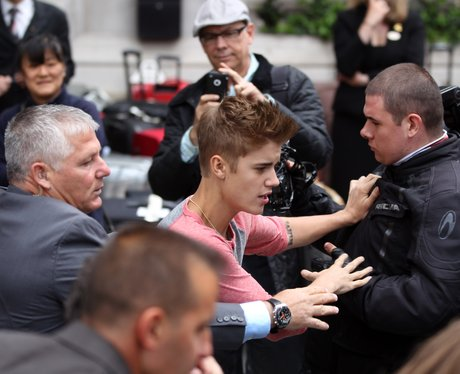 Justin Bieber meets fans outside his hotel.