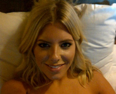 Mollie King lying in bed