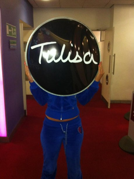 Tulia standing with drum logo