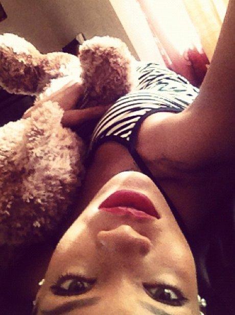 Rihanna cuddling a teddy bear
