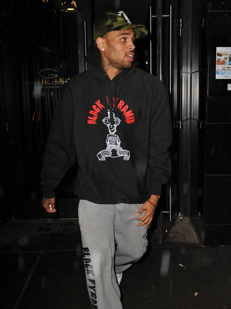 Chris Brown leaving Rihanna's hotel in New York.