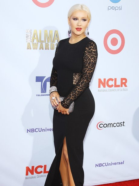 Christina Aguilera in a black dress on the red carpet