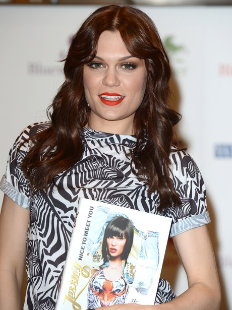 Jessie J signs a copy of her new book