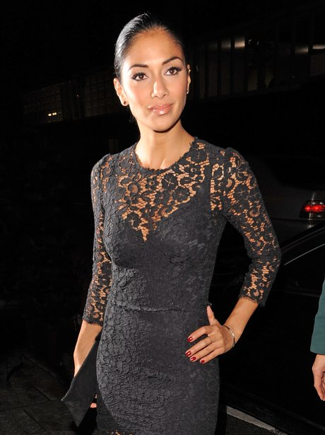Nicole Scherzinger in a tight black lace dress.