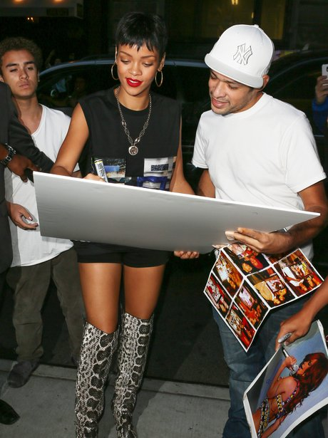 Rihanna signs fan autographs in New York.