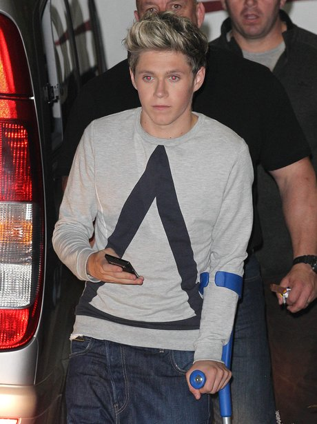 Niall Horan from One Direction on crutches.