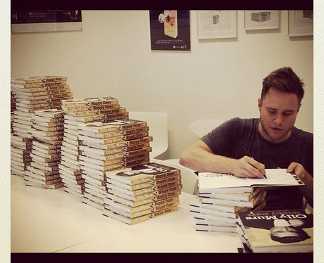 Olly Murs signing autobiographies.