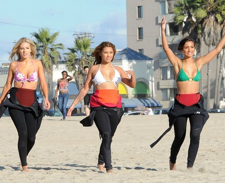 The Saturdays surfing in America