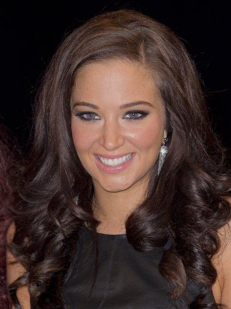 Tulisa Contostavlos returns to her brunette hair.