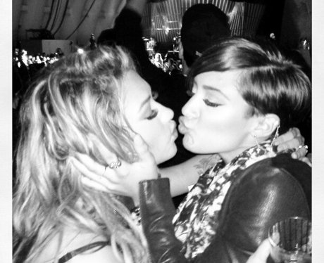 Vanessa White and Frankie Sandford kissing.
