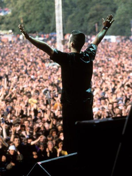 Robbie Williams performs at Glastonbury 1996