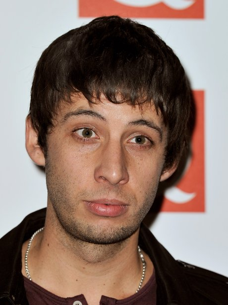 Example attends the Q Awards