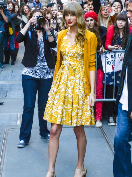 Taylor Swift wearing a yellow dress in New York