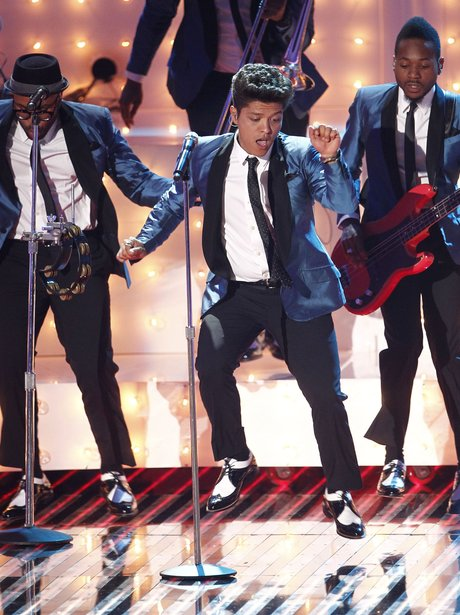 Bruno Mars performing live on stage