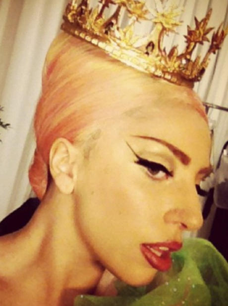 Lady Gaga wearing a crown.