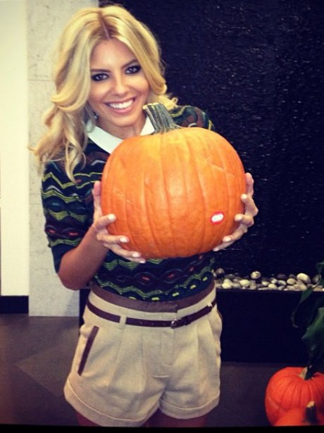 Mollie King with a pumpkin