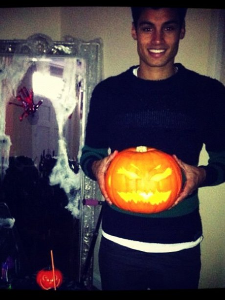 Siva from The Wanted holding a pumpkin