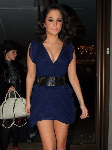 Tulisa wearing a short blue dress.