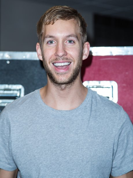 Calvin Harris smiling in grey t-shirt