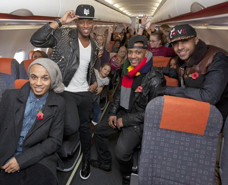JLS on a plane with their fans