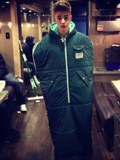 Justin Bieber in a sleeping bag.