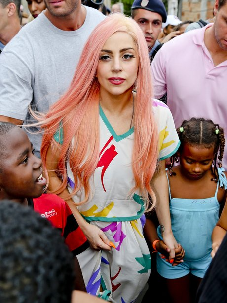 Lady Gaga visits slums in Rio and is mobbed by fans