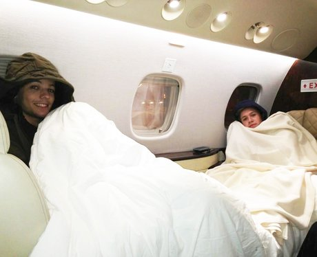 Niall Horan and Louis Tomlinson on a plane.