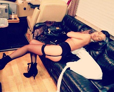 Rihanna wearing suspenders.