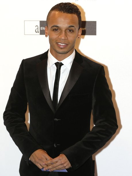 Aston Merrygold in a suit