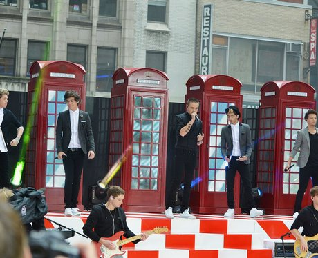 One Direction in telephone boxes performing 'What Makes You Beautiful'