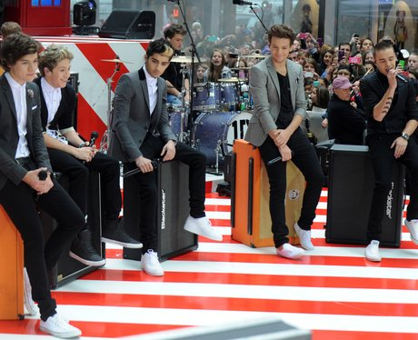 One Direction sitting down while performing on The Today Show