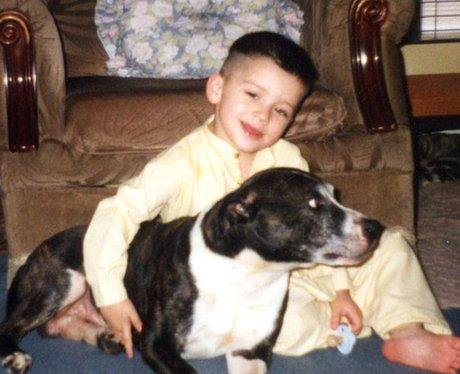 Zayn Malik cuddling dog as a baby