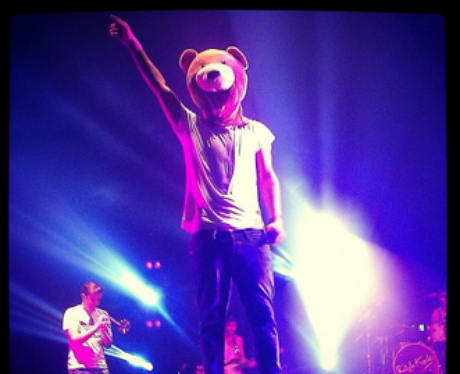 Rizzle Kicks wears a bear mask on stage