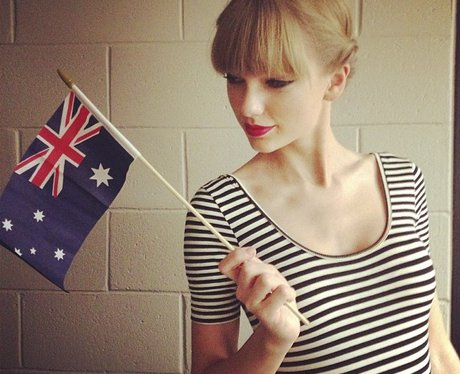 Taylor Swift waves an Australian flag