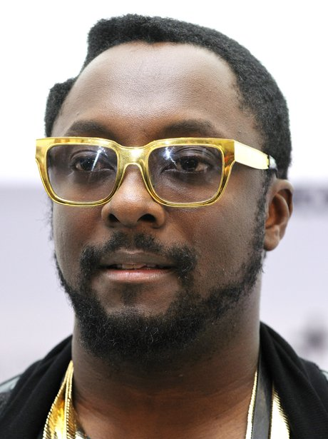 Will.i.amw earing gold rimmed glasses