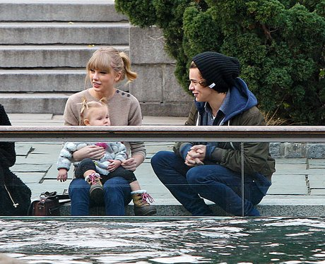 Taylor Swift holding a baby with Harry Styles