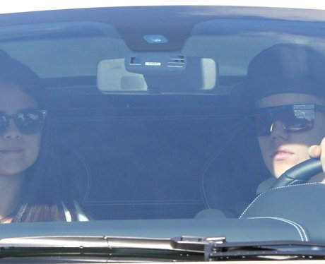 Justin Bieber and Selena Gomez in his Ferrari