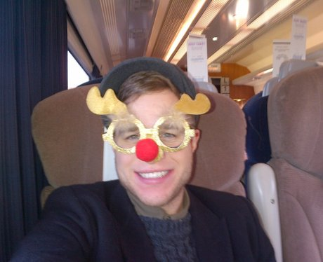 Olly Murs with a reindeer mask