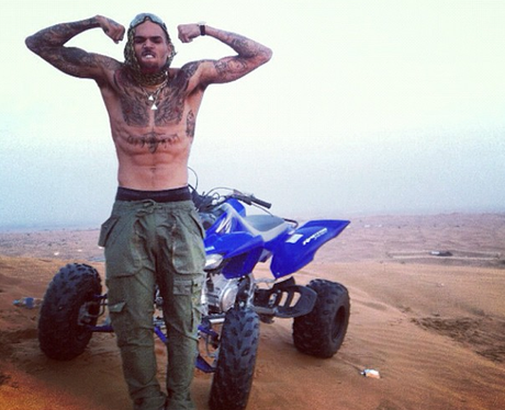 Chris Brown flexing his muscles