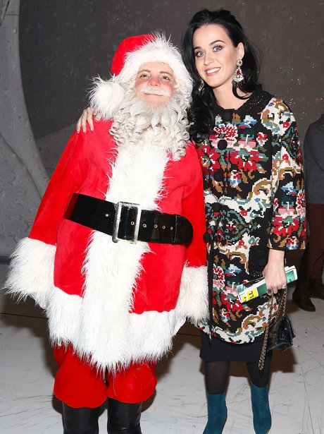 Katy Perry poses with a Santa at Broadway show