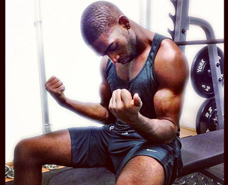 Tinie Tempah flexing his muscles in the gym