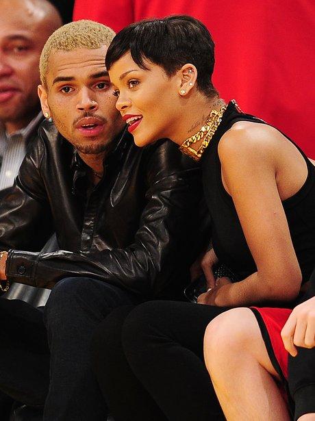 Rihanna and Chris Brown watching basketball together