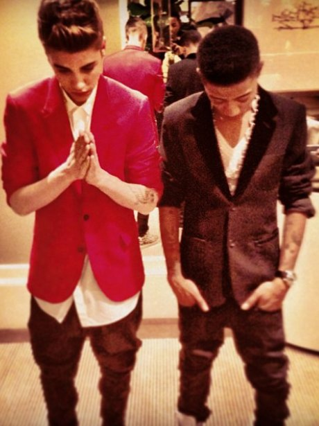 Justin Bieber wearing a red suit jacket