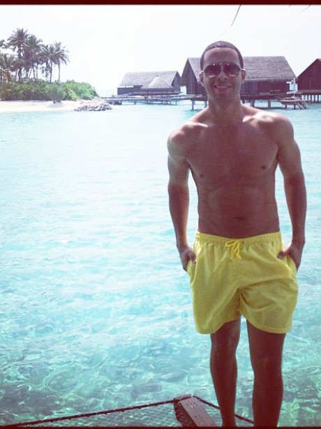 Marvin Humes of JLS wearing yellow swimming shorts