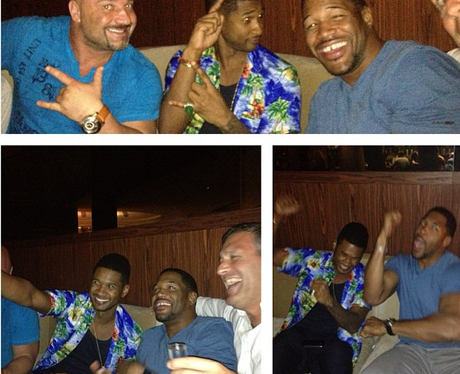 Usher wearing a hawaiian shirt