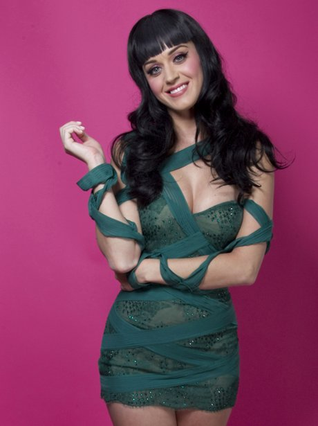 Katy Perry wearing a tight green dress